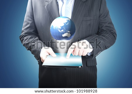 Businessman holding the tablet PC with 3D digital globe
