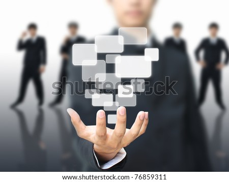 Businessman holding touch screen - stock photo
