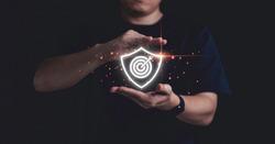 Businessman holding virtual dartboard with arrow ,Business Achievement objective target concept.
