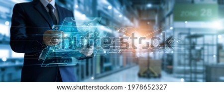 Businessman holding virtual interface panel of global logistics network distribution and transportation, Smart logistics, Innovation future of transport on large warehouse center background