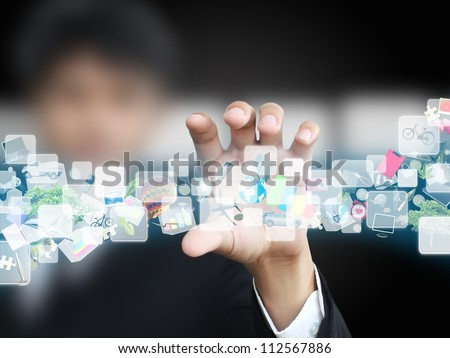 Businessman holding virtual object