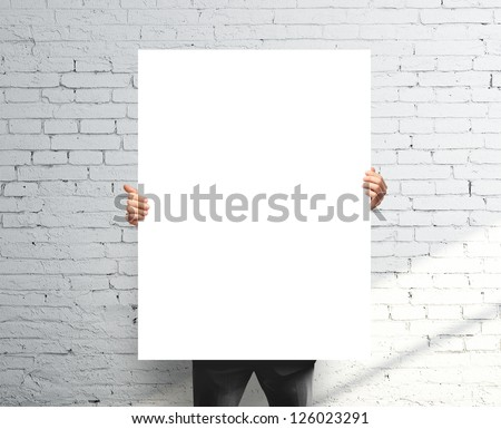 businessman holding white blank poster