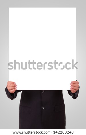 Businessman holding white blank poster with space for your design.
