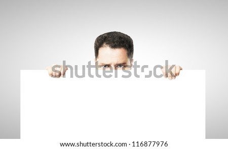 businessman holding white empty poster