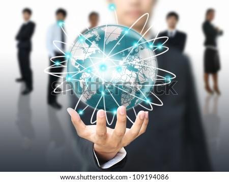Businessman holding world network
