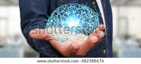 Businessman holding x-ray human brain in his hand with cell and neurons activity 3D rendering #482388676