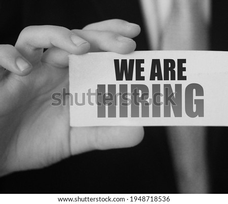 Businessman holds a card with the text We Are Hiring. Business concept Сток-фото ©