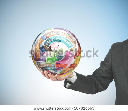 Businessman holds a globe with internet concepts
