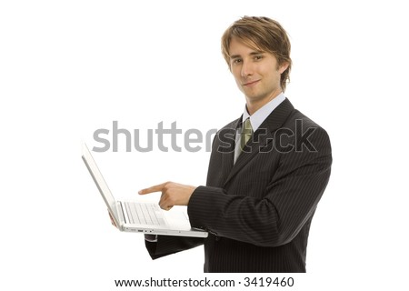 Businessman holds a laptop and points to the screen