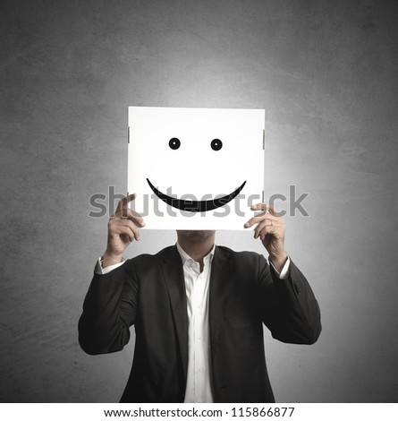 Businessman holds a paper with a smile