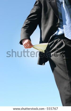 Businessman, holds a pocket inside-out, symbolizing emptiness.