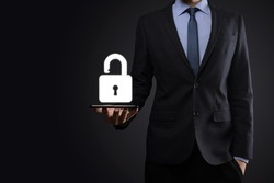 Businessman holds an open padlock icon on his palm.unlocking a virtual lock. Business concept and technology metaphor for cyber attack, computer crime, information security and data encryption
