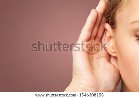 Businessman holds his hand near his ear and listening something Foto d'archivio ©