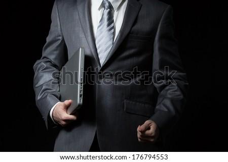 businessman holds laptop Foto stock ©