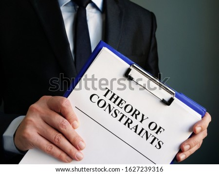 Businessman holds toc theory of constraints papers. Stock photo ©