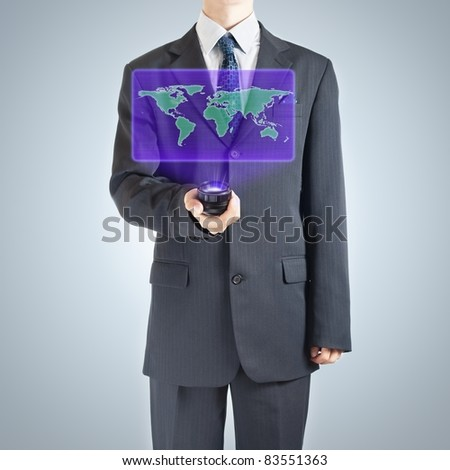 Businessman holographic projection of Earth map as a symbol of globalization.