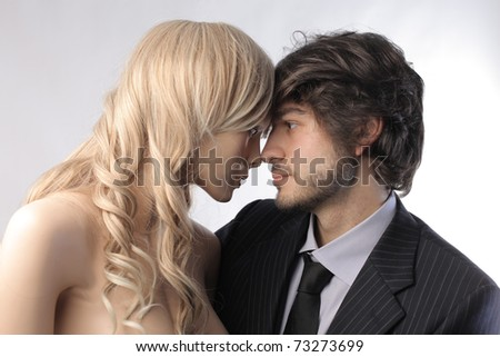 Businessman hugging a female mannequin