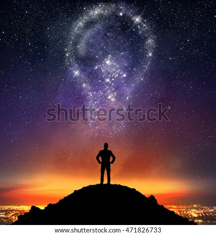 Businessman illuminated by a bright idea #471826733