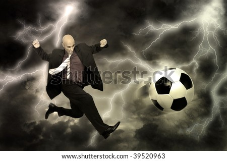 Businessman in a acrobatic pose kicking a soccer ball in a stormy sky