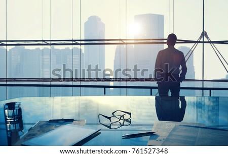 Businessman in a big office