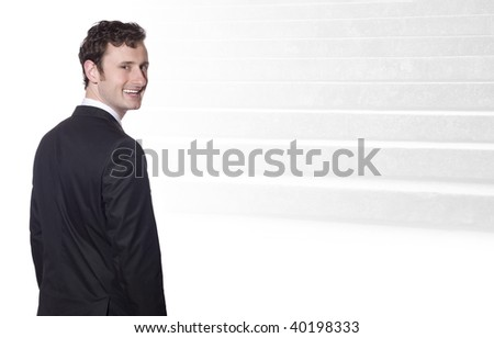 businessman in a black suit is smiling, in the background the steps to success