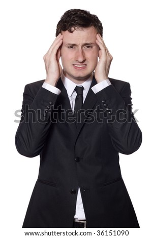 businessman in a black suit with headache isolated on white
