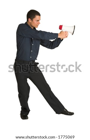 Businessman in a blue shirt, playing with a megaphone as if it is a gun.