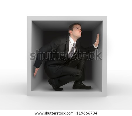 Businessman in a box - stock photo