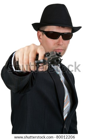 businessman in a hat and sunglasses with a gun on a white background