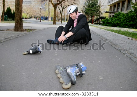 Businessman in a lot of pain from rollerblading