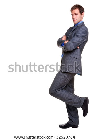 Businessman in a pinstripe suit leaning with his arms folded, looking at camera, isolated on a white background.