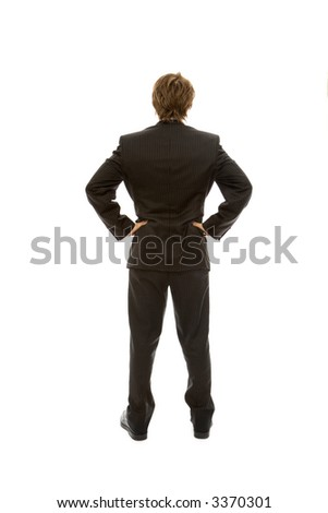 Businessman in a suit faces away with confidence