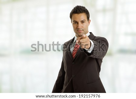 businessman in a suit pointing with his finger at the office #192157976