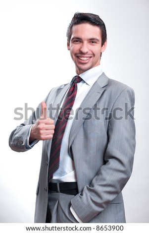 businessman in a suit shows ok