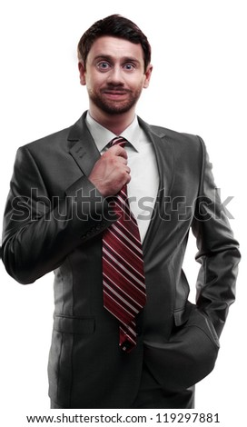 Businessman in a suit straightens his tie. isolated on white background
