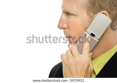 Businessman in a suit uses a cellular phone
