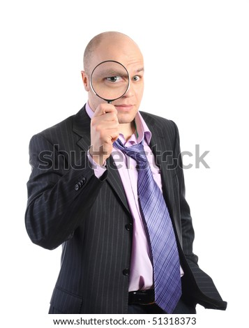 Businessman in a suit with a magnifying glass. Isolated on white background - stock photo