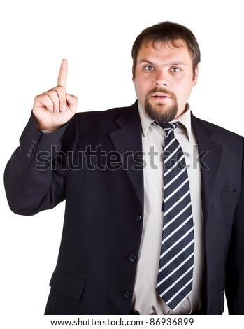 Businessman in a suit with a raised index finger, isolated on white background