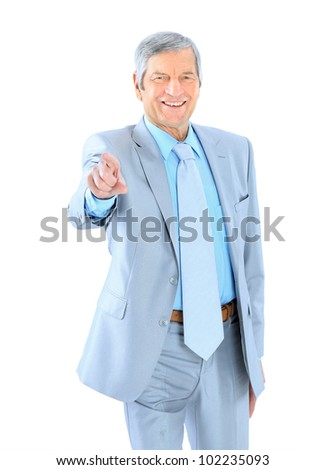 Businessman in age, points his finger. Isolated on a white background.