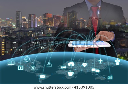 businessman in black suite using tablet control the world , internet of things concept #415091005