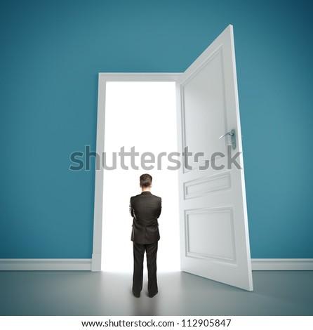businessman in blue room with doors open