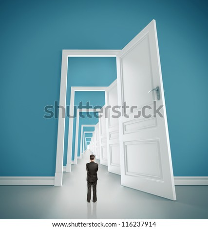 businessman in blue room with doors open