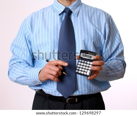 Businessman in blue shirt with calculator and pen isolated