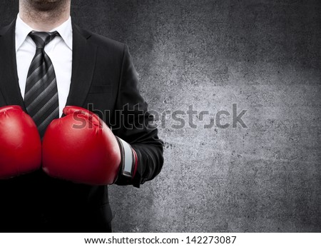 businessman in boxing gloves on background ストックフォト ©