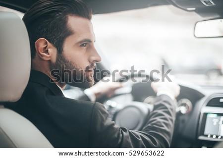 businessman in car. rear view...