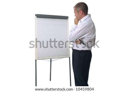 Businessman in casual attire looking thoughtfully at a blank flip chart, good shot for brainstorming ideas. Isolated on white.