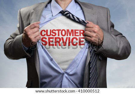 Businessman in classic superhero pose tearing his shirt open to reveal t shirt with customer service concept for assistance, contact us, helpdesk, helpline and business support