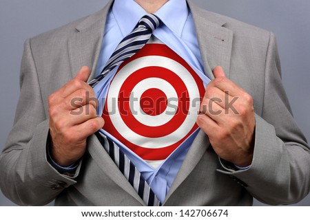 Businessman In Classic Superman Pose Tearing His Shirt