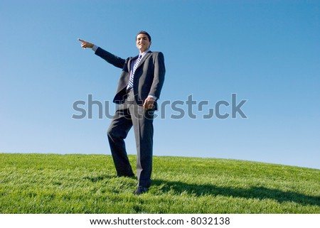 Businessman in dark suit pointing with his finger