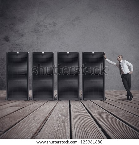 Businessman in datacenter server room